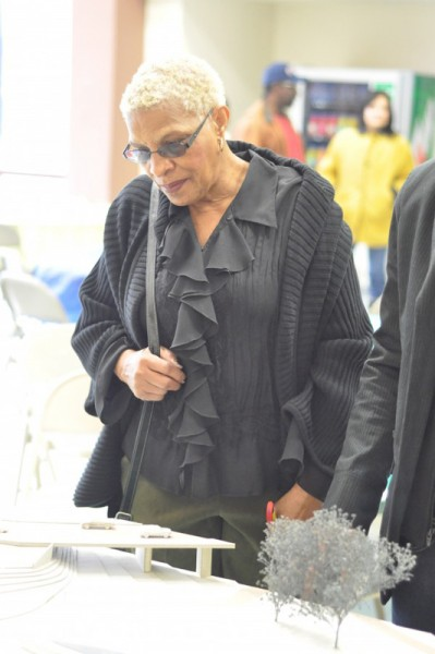 Vickie Miller, Doris Miller's niece, viewing the Memorial Project maquette